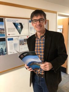 Institute for the Study of Social Change Director Professor Richard Eccleston with the latest Insight Report on regulating short-stay accommodation in Tasmania.